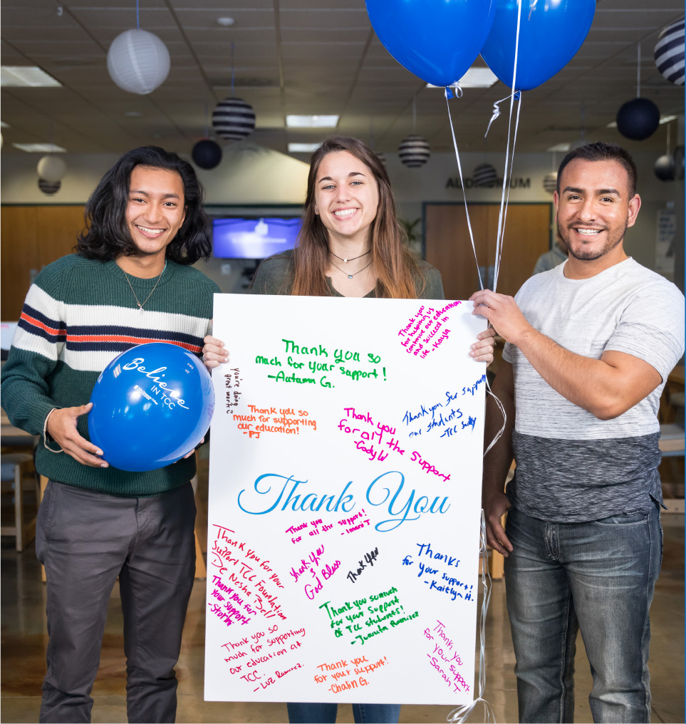 TCC Students holding a poster sized thank you note