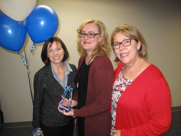 President Leigh Goodson and Dr. Cindy Hess pose with Paula Settoon during the surprise Goody Award presentation.
